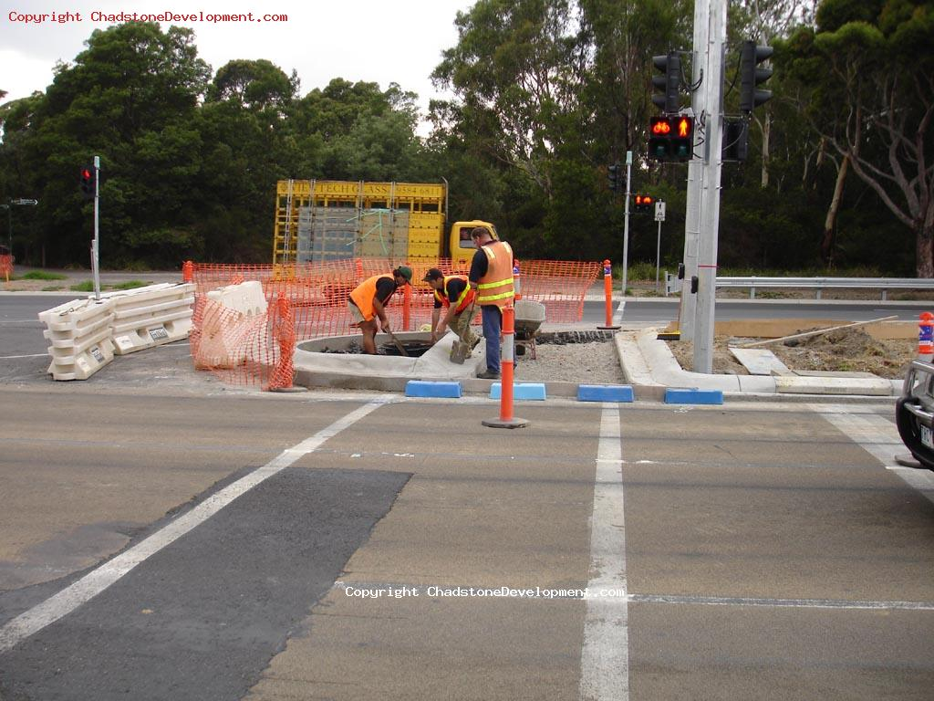 workers fixing the Warrigal Rd pedestrian crossing - Chadstone Development Discussions
